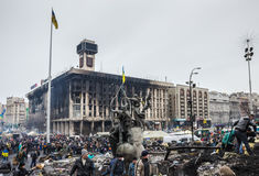 Maidan after cessation of clashes. Kiev, Ukraine - February 22, 2014: the burnt house of Trade Unions  and Maidan after the cessation of collisions. People Stock Photo