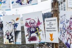 Maidan - dessins satiriques de Yanukovych et de Poutine Image stock