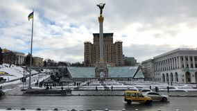 Maidan Independence Square traffic on a snowy winter afternoon. KIEV, UKRAINE, January 3, 2017. Traffic on Khreshchatyk street crossing Maidan Nezalezhnosti, or stock video