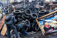 Maidan - Journalists take pictures of activists on barricades at Royalty Free Stock Photos