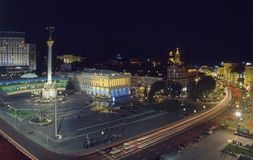 Maidan Nezalezhnosti square top evening view. Top view of Maidan Nezalezhnosti square at evening time. Buildings are illuminated. Blossom  horse chestnut trees Royalty Free Stock Photo