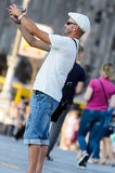 MAIDAN PLACE, KIEV, UKRAINE – SEPTEMBER 6, 2016: Male tourist filming himself with a video camera. MAIDAN PLACE, KIEV, UKRAINE – SEPTEMBER 6, 2016: Male Stock Image