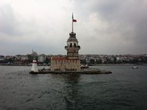 Maiden`s Tower, cruise on the Bosporus. Rainy day, cloudy sky. royalty free stock photos