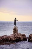 Maiden with the seagull statue with the Adriatic sea in the background in Opatia , Croatia Royalty Free Stock Images
