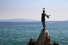 Maiden with the seagull statue and Adriatic Sea Opatija Croatia stock photography