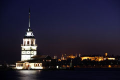 Maiden Tower. At night, Istanbul. In the distance are such landmarks as Hagia Sophia and Topkapi Palace Stock Images