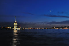 Maiden Tower with Moon. Night view of Maiden tower in Istanbul Stock Images