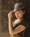 Maiden wearing a hat Stock Photography