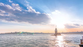 Maidens tower before sunset timelapse in istanbul, turkey, kiz kulesi tower. Maidens tower before sunset with colorful clouds and rays of sun light timelapse in stock footage