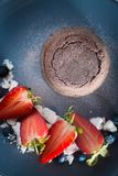 Lava cake, blueberries and stawberries Stock Images