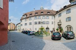 Maienfeld, GR / Switzerland - April 13, 2019: historic Swiss village of Maienfeld with the town square and a decorated village royalty free stock images