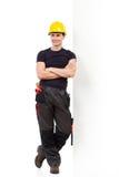 Maigre de attente de mécanicien sur le mur Photo libre de droits
