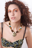 Maike6. The beautiful girl with curly hair from a necklace from natural stones on a neck and black lacy underwear Stock Photo