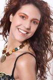 Maike7. The beautiful girl with curly hair from a necklace from natural stones on a neck. She smiles Stock Image