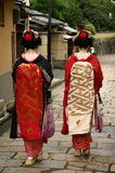 Maiko. Two maiko women walking down the street of Kyoto, Japan Stock Image