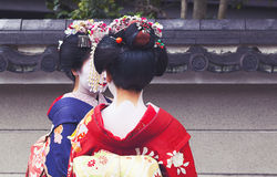 Maiko couple walking in Kyoto, Japan Stock Photo