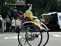 Maiko girl riding in a rickshaw, Kyoto Japan. Stock Photo
