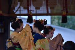Maiko girls dancing, Kyoto Japan. Dancing Maiko girls in beautiful Kimono dress at the stage of Yasaka shrine in winter, Kyoto Japan Stock Photography