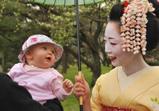 Maiko Kosen(Geisha) meet little cute western baby Stock Photos