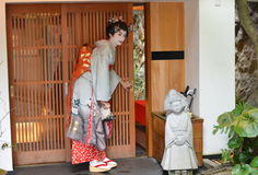 Maiko opens sliding door, Kyoto, Japan Royalty Free Stock Photography