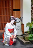 Maiko posing with traditional Japanese decorations, Kyoto, Japan Stock Photography