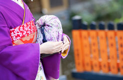 Maiko's hands with traditional bag Royalty Free Stock Photos