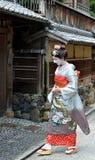 Maiko walking in Kyoto's street. KYOTO, JAPAN - JULY 2: Maiko walking in Kyoto street. Apprentice geisha in Japan. Their jobs consist of performing songs, dances Stock Images
