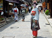Maiko walking in Kyoto's street Royalty Free Stock Image