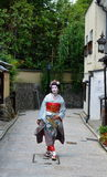 Maiko walking in Kyoto's street, Japan Royalty Free Stock Photos