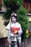 Maiko walking in Kyoto's street, Japan Stock Photos