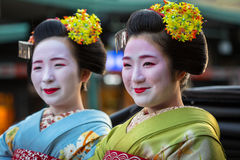 Maiko women, apprentice geisha on the street parade in Kyoto Stock Photo