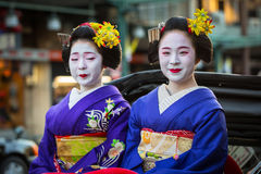 Maiko women, apprentice geisha on the street parade in Kyoto Stock Images