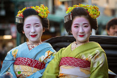 Maiko women, apprentice geisha on the street parade in Kyoto Royalty Free Stock Image