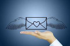 Mail with angel wing on Human hand Royalty Free Stock Photos