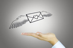 Mail with angel wing on Human hand Stock Photo