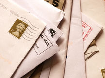 Mail awaits attention. A pile of business mail in unopened envelopes awaits attention Stock Image