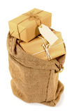 Mail bag or sack filled with wrapped packages, isolated white background Stock Photos