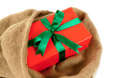 Mail bag or sack with small red Christmas gift isolated on white background Royalty Free Stock Image