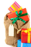 Mail bag or stocking filled with Christmas gifts isolated on white background Stock Photo
