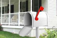Mail Box. Image of white mail box in front of the house stock photo