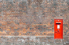 Mail box in a brick wall Stock Photography
