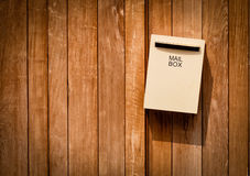 Mail box on brown wood background Royalty Free Stock Photography