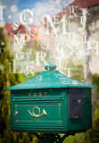Mail box with letters comming out Royalty Free Stock Image