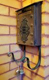 Mail box. Vintage metal mailbox with bells on a brick wall Stock Images