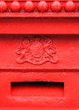 Mail box. Old English red mailbox detail showing coat of arms and mail slot Royalty Free Stock Photos