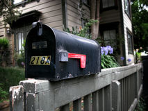 Mail box on a railing Stock Photography