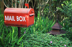 Mail Box. Red mail box in the garden Stock Image