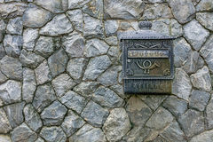 Mail box on a stone wall stone wall texture.  Stock Image