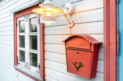 Mail box, window and lamp on a white wooden house Stock Photos
