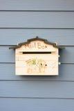 Mail box on wood wall Stock Photo